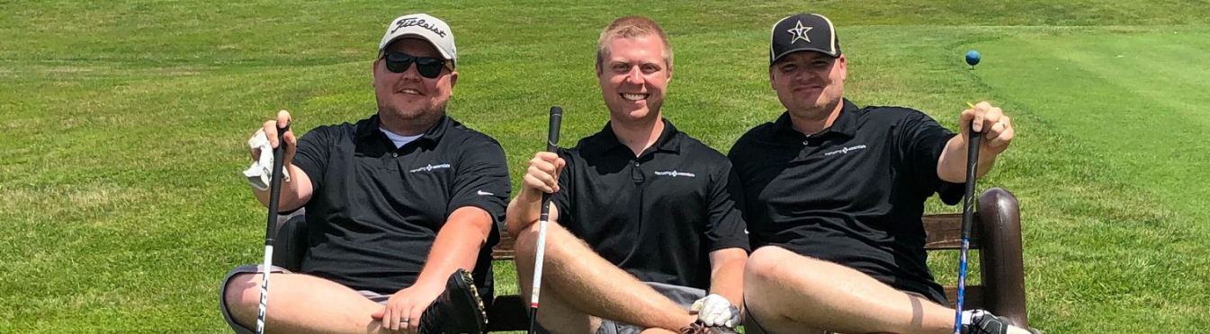Marketing Essentials team at charity golf outing